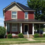 premier-legacy-rib-black-hearttech-d5dl-mountain-berry-vinyl-siding-clay-gutters-and-downspouts-barnsville